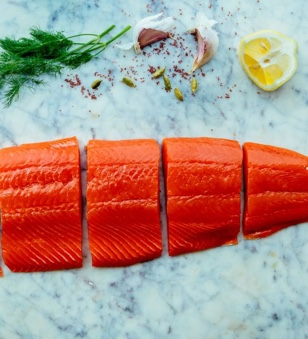 Poaching salmon is similar to steaming, but doesn't require any special tools. Add ingredients to the poaching water such as white wine, lemon, dill and garlic so the salmon gets a flavor boost during cooking.