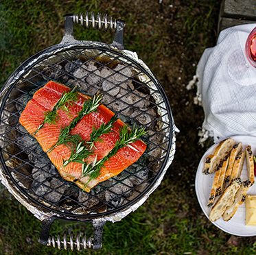 H erb threaded grilled salmon is a new take on herb crusted salmon,